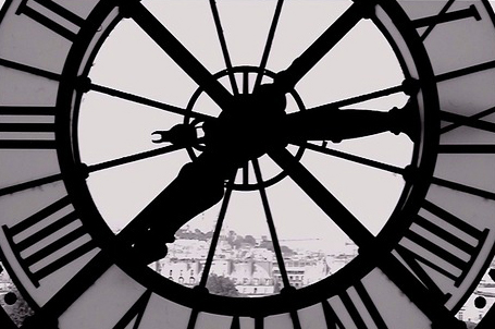 Image of a clock looking out over a city