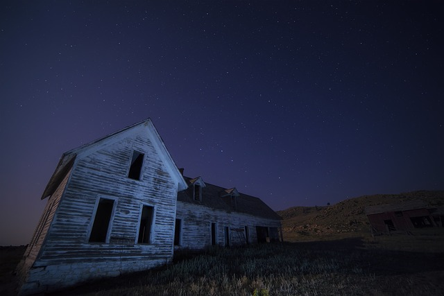 "Photo of an abandoned house at night for the blog post titled:""He Wasn't Alone in the House..."" by Literative.com."
