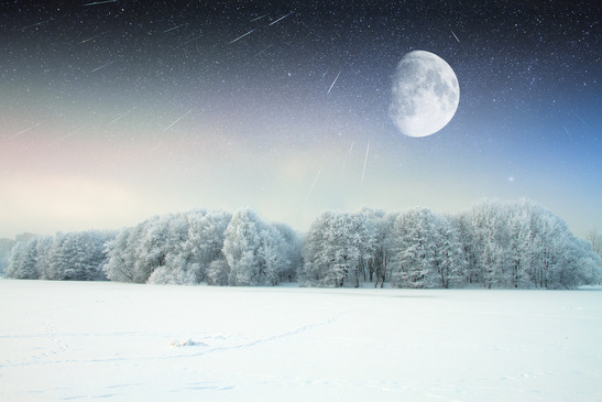Picture of the moon over a cold, snowy landscape