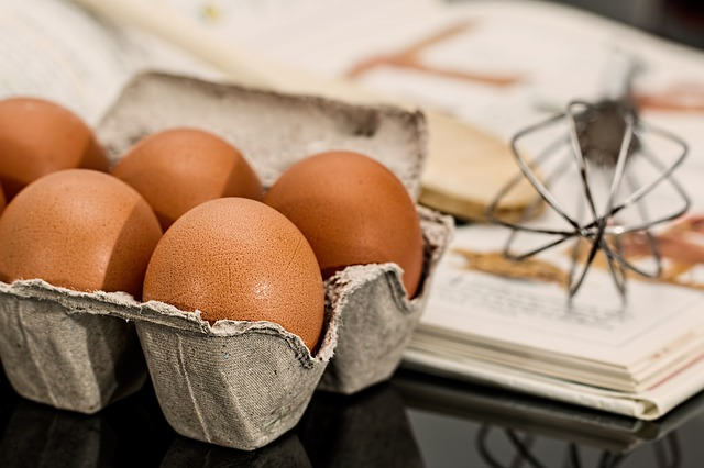 Photo of eggs, a whisk, and a recipe book
