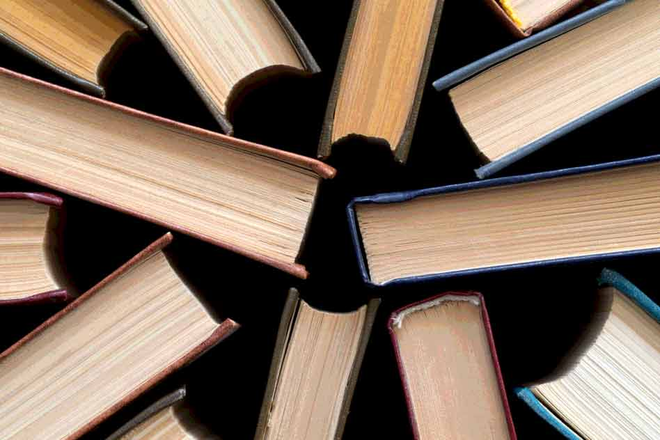 Photo of old and used hardback books.